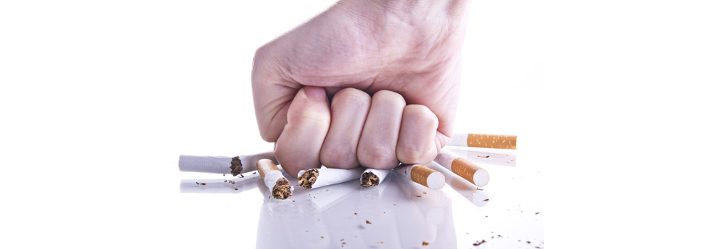 stock-photo-36888376-woman-hands-cutting-ciggarette-for-quitting-smoking.png